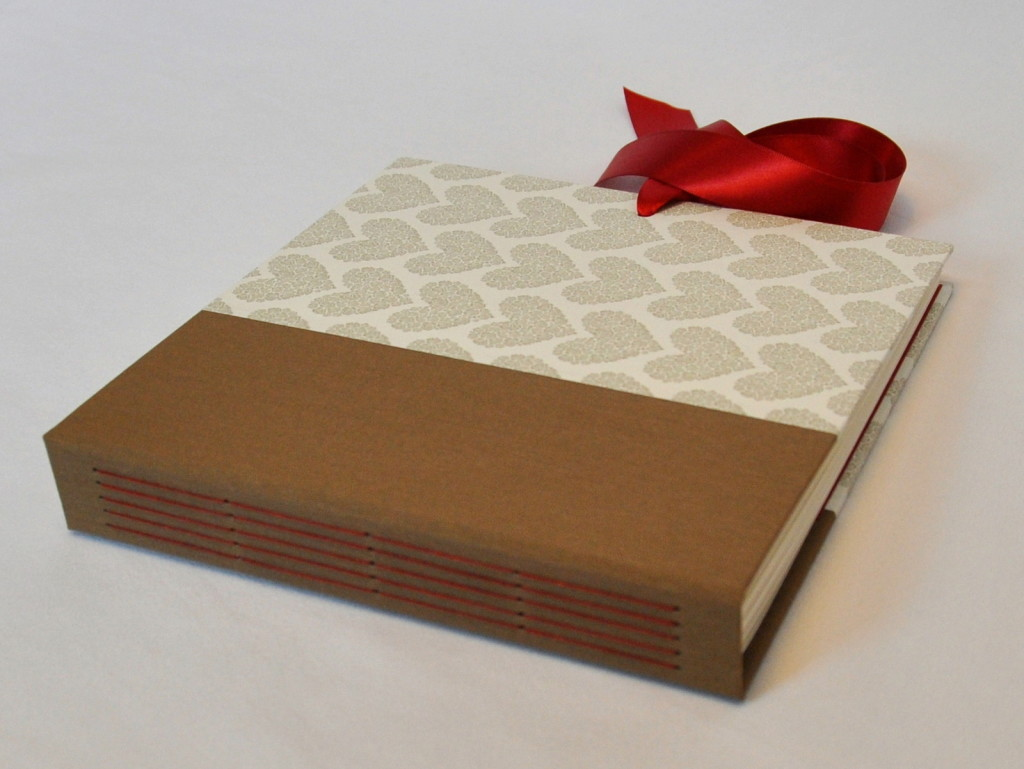 Bookbinder Kris Stewart will win over your heart with this lovely album crafted with Letterpress paper