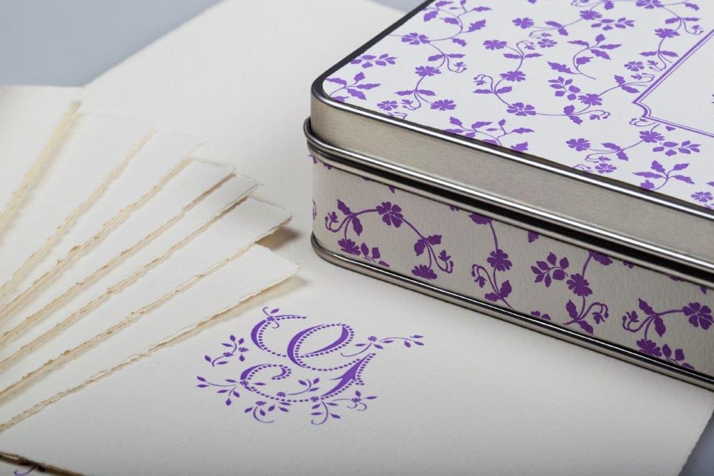 Classy touch: a thank you on monogramed stationery. This product comes in a reusable tin box.